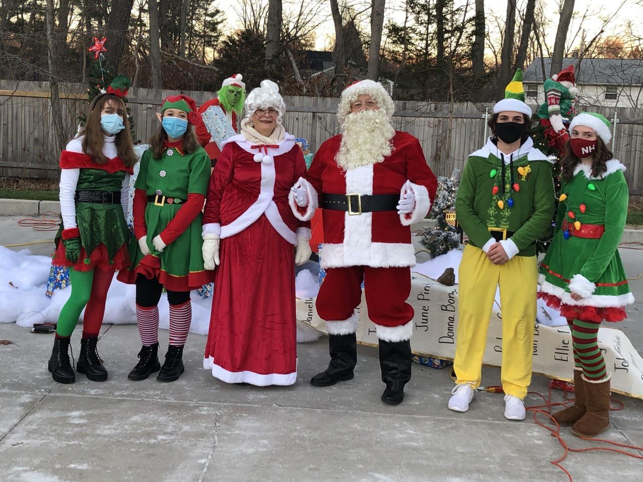 Santa Claus, Mrs. Claus, and their elves.